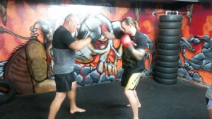 Greg holding pads for Mick, during Tues night boxing class!